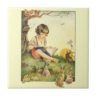Boy reading under tree with rabbits tile
