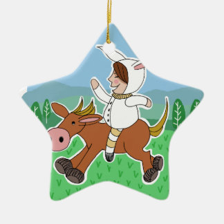 Boy riding a horse christmas ornament