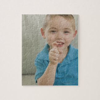 Boy signing the letter 'X' in American sign Jigsaw Puzzle