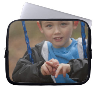 Boy signing the word 'Swing' in American Sign Laptop Sleeve