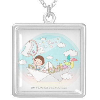 Boy sitting in paper boat silver plated necklace