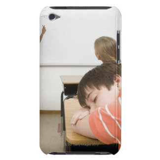 Boy sleeping on desk in classroom iPod touch cover