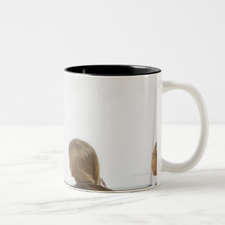 Boy sleeping on desk in classroom Two-Tone mug