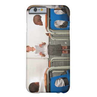 Boy standing in front of class reading in barely there iPhone 6 case