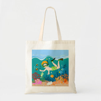 Boy swimming and diving with tropical fish budget tote bag