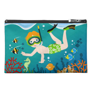 Boy swimming and diving with tropical fish travel accessory bags