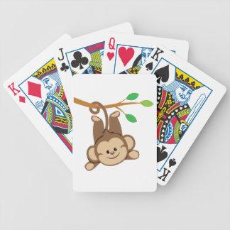 Boy Swinging Monkey Playing Cards