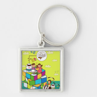 Boy with a girl sitting on a Rubik's cube puzzle Silver-Colored Square Key Ring