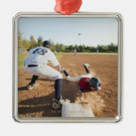 Boys (10-11) playing baseball christmas ornament