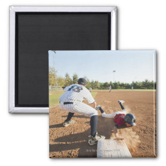 Boys (10-11) playing baseball magnet