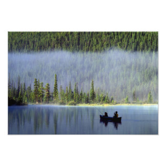 Boys fishing from canoe with mist in photograph