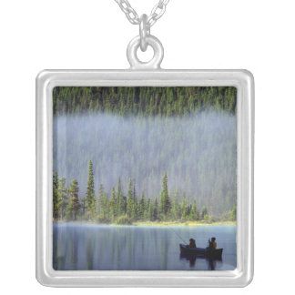 Boys fishing from canoe with mist in silver plated necklace