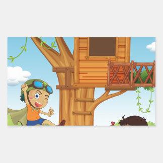 Boys playing in the garden rectangular sticker