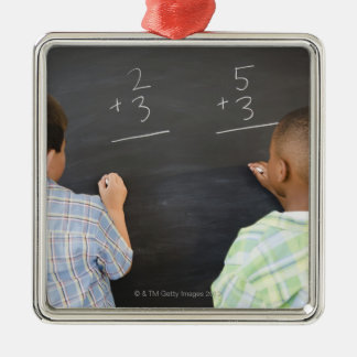 Boys solving math problems on blackboard Silver-Colored square decoration