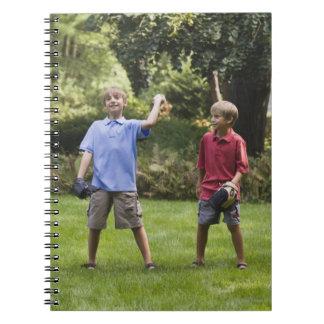Boys throwing baseball notebook