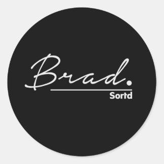 Brad signature on black background round sticker