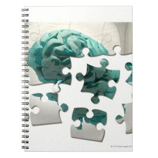 Brain analysis, conceptual computer artwork. spiral notebook