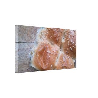 Bread on wooden cutting board canvas print