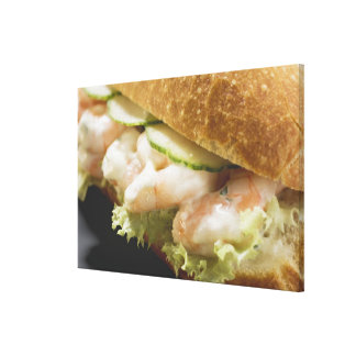 Bread roll filled with shrimps cucumber and stretched canvas print