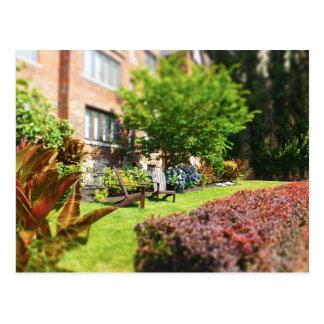 Brick Home, Adirondack Wooden Chairs, Shrubs Plaza Postcard
