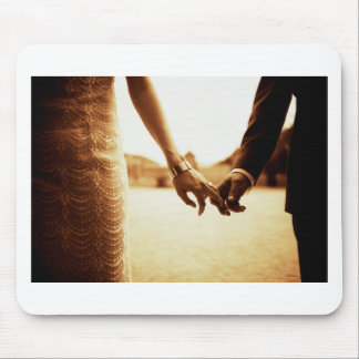 Bride and groom holding company hands in sepia ana
