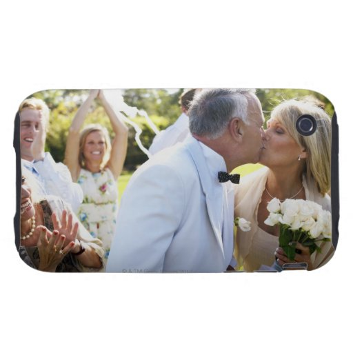 Bride and groom kissing wedding guests in iPhone 3 tough case