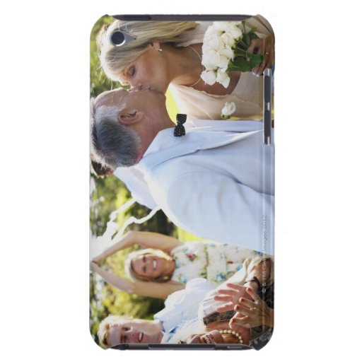 Bride and groom kissing wedding guests in iPod touch cases
