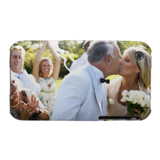 Bride and groom kissing wedding guests in iPhone 3 cover