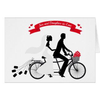 bride and groom on wedding bicycle greeting card