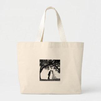 Bride Kiss under Oak Bag