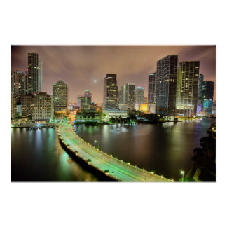 Bridge leads across waterway to downtown Miami Poster