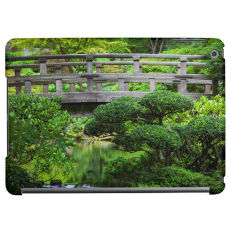 Bridge Over Pond In The Japanese Garden