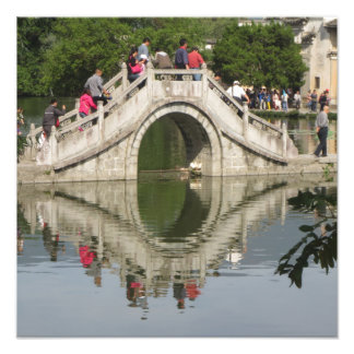 Bridge reflected in lake photographic print