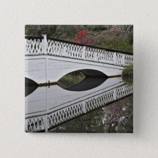 Bridge reflecting on pond, Magnolia 15 Cm Square Badge