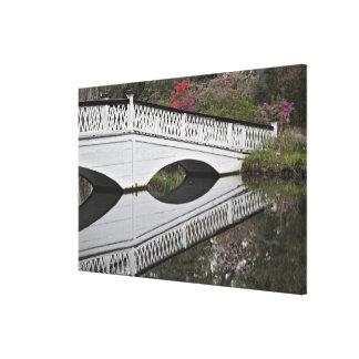 Bridge reflecting on pond, Magnolia Canvas Print