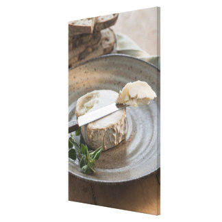 Brie cheese on plate canvas print
