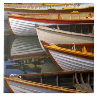 Bright colored boats at the Wooden Boat Center Large Square Tile