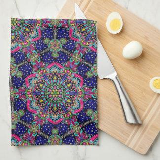 Bright colorful mandala pattern on dark blue tea towel