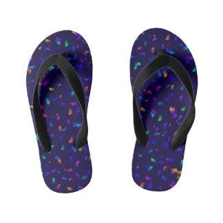 Bright colorful neon confetti on dark flip flops