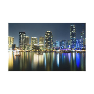 Bright lights of a cosmopolitan city stretched canvas print