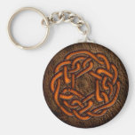 Bright orange celtic knot on leather keychain