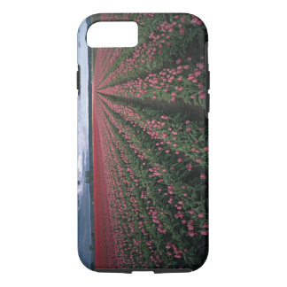 Bright pink and red tulips glow under dark iPhone 7 case
