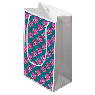 Bright pink, purple hand sewn flowers on turquoise small gift bag