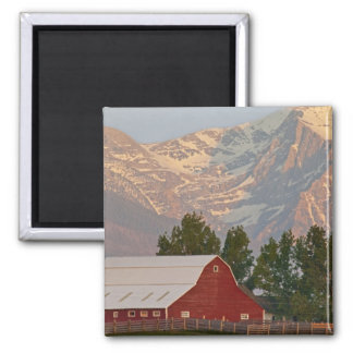 Bright red barn against Mission Mountains in Magnets