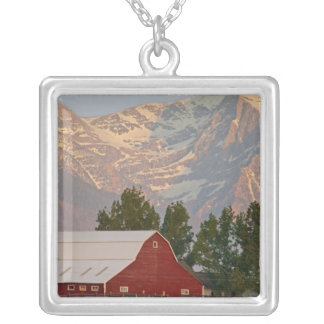 Bright red barn against Mission Mountains in Silver Plated Necklace