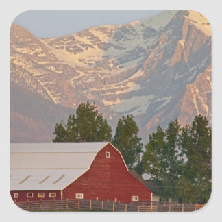 Bright red barn against Mission Mountains in Square Sticker