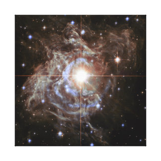 Bright star in star cluster. stretched canvas print