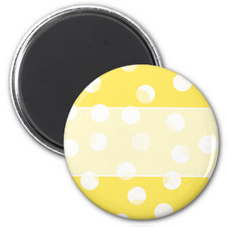 Bright yellow, light yellow, white spotty pattern. 6 cm round magnet