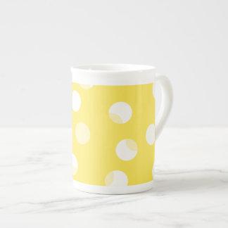 Bright yellow, light yellow, white spotty pattern. porcelain mug