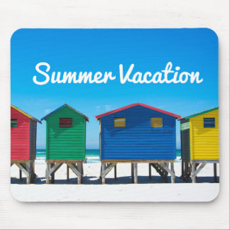 Brightly painted beach huts with blue sky mouse mat